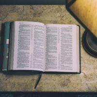 Bible under a light