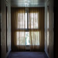 Image of a curtained window