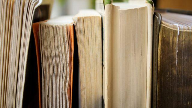 Photo of well-used books on a shelf